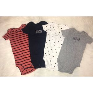 Set of four Carter's onesies (12 months)